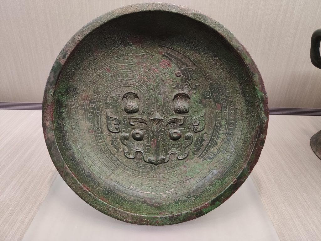 Pan water vessel with coiling dragon pattern (13th to 11th BCE)