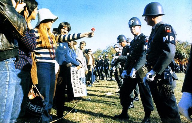 The famous episode of a demonstrator offering a flower to the police during a demonstration against the Vietnam War, 1967